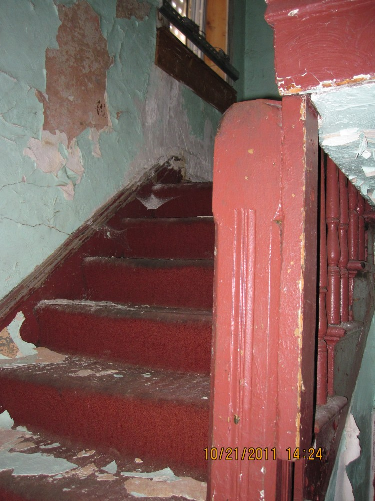Staircase prior to gut rehab